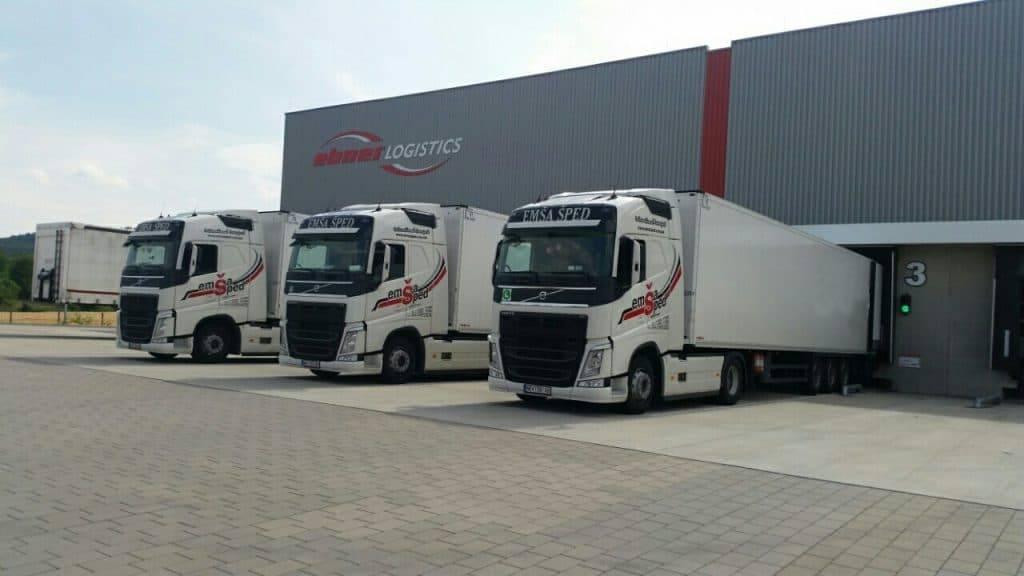 logistics services emsa sped trucks facing left